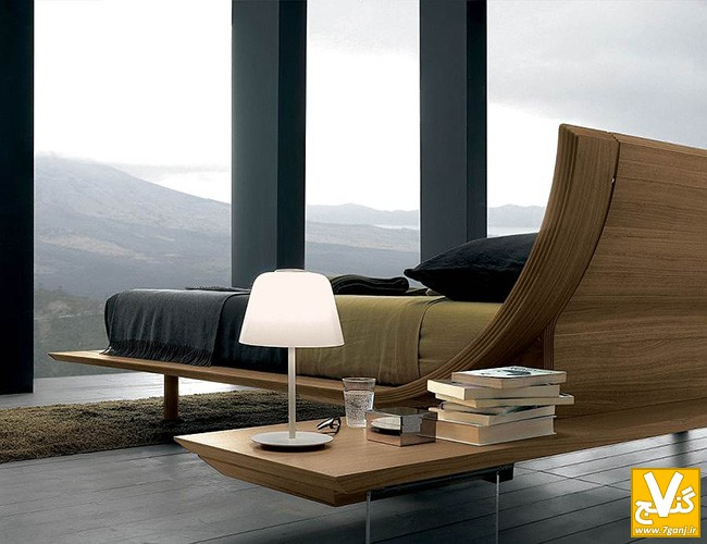 Sturdy-black-concrete-pillars-between-unframed-glass-walls-on-villa-bedroom-interior-design-with-modern-wooden-bed-facing-directly-to-the-blessed-mountain-scenery